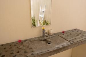 Master bedroom sink and towel rack in the mirror