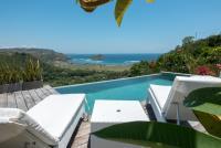 Villa Atas Pelangi pool with lounge chairs and beautiful scenery
