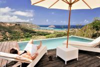 Relaxing next to the pool at Villa Atas Pelangi